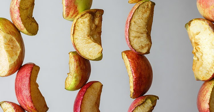 Drying multi-colored pieces of apples, close-up.